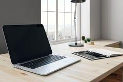 Modern arbetsplats med bärbar datorsidan Fotografering för Bildbyråer
