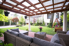 Modern arbour with garden furniture. Designed modern arbour with comfortable garden furniture Royalty Free Stock Images