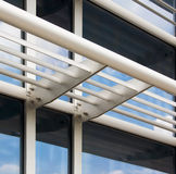 Modern Architectural Detail. Architectural detail of a glass face of a modern building featuring energy efficient louver system royalty free stock images