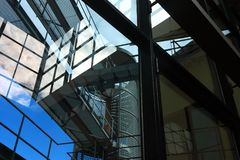 Modern architectural elements with reflections and blue sky stock photo