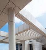 Modern architectural features of the Getty. Tile roof and pillars and stone wall at the Getty Museum, Los Angeles, California Royalty Free Stock Photography
