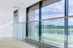 Modern architectural interior detail. With wide ranging views over open countryside beyond glass balcony royalty free stock images