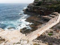 Modern Stone Retaining Walls, Bronte Cliffs, Sydney, Australia. Modern architecturally designed stone retaining walls on Pacific Ocean side cliffs at Bronte, on stock photo