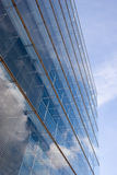 Modern architecture. Modern corporate building with sky reflecting on its glassy facade Royalty Free Stock Photography