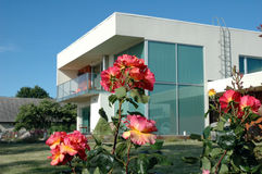 Modern architecture. House with roses Stock Images