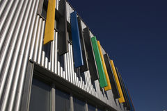 Modern architecture. A modern metal building with coloured stripes royalty free stock photos