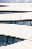 Modern architecture. Modern office building facade reflecting cloudy sky Royalty Free Stock Photography