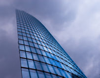 Modern Architecture. Photograph of modern architecture against a cloudy sky Royalty Free Stock Photography