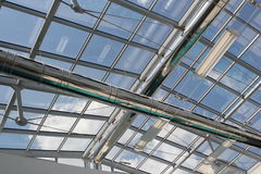 Modern Architecture. Blue sky through the glass roof Stock Photos