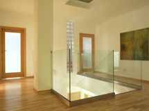 Modern architecture. Contemporary hallway with glass staircase royalty free stock image
