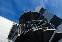 Modern Architecture. Low angle of a modern building looking up to spiral stairs Royalty Free Stock Photo