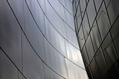 Modern architecture. Closeup of curved shiny walls of modern building exterior Stock Photography