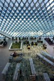 Modern architecture. It is the main lobby of Seattle Central library. It has unique glass roof and indoor layouts. The interior design is very interesting too Stock Image