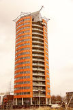 Modern architecture. A round apartment building, stlll under construction Royalty Free Stock Image