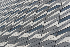 Modern architecture. Patterned wall of a modern building made of metal and glass Royalty Free Stock Photo
