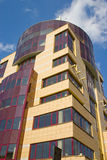 Modern Architecture. Modern building from a brick. Glass windows and balconies Stock Images