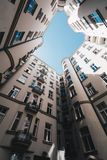 Modern architecture apartments. A high living building seen from low point of view Royalty Free Stock Photography