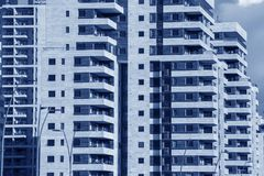 Modern Architecture background - generic High rise apartment bui. Lding front view with balcony facade.Conceptual image for Urban development theme,construction Royalty Free Stock Photography