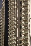 Modern Architecture background - generic High rise apartment bui. Lding front view with balcony facade.Conceptual image for Urban development theme,construction Royalty Free Stock Photo