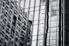 Modern architecture black and white fragment. Modern architecture abstract black and white fragment, walls made of glass and steel with reflections Royalty Free Stock Photos