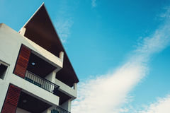 Modern architecture building on blue skies background. Royalty Free Stock Photography