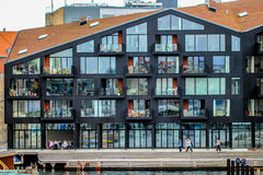 Modern architecture building in COpenhagen. People next to new house, most of the wall is made from the glass, to get a good insight into how people are living Royalty Free Stock Photos