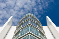 Modern architecture building glass. Looking up to modern architecture building glass and blue sky Royalty Free Stock Photos