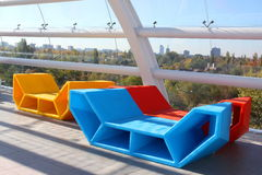 Playground for children. Modern architecture building interior with colored benches orange blue and red sunlight. Playground for children Royalty Free Stock Image