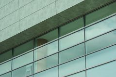 Modern architecture building. Windows glass refflection at beautiful sunny day Stock Images