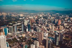Modern architecture, business office building, cityscape background. Kuala Lumpur skyline. Travel to Malaysia. Urban skyscrapers. Royalty Free Stock Photo