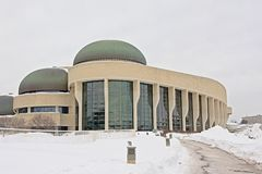 Canadian history museum on a cold winter day with snow. Modern architecture of the Canadian history museum on a cold winter day with snow in Gatineau, Quebec royalty free stock photo