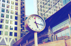 Modern architecture of Canary Wharf business aria and clock on the main square. London Royalty Free Stock Images