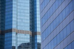 Modern architecture close up with mirror window reflection. Bang Stock Image