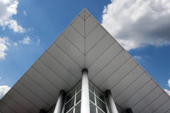 Modern Architecture. The combination of modern materials and colors in the roof facade of the modern business building Stock Photography