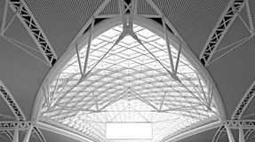 Modern architecture : curvy steel roof structure design. Modern architectural design : curvy wave shaped steel roof with blank billboard royalty free stock images