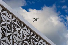 Modern architecture design and airplane in blue sky. Abstract modern architecture design background like propeller and airplane in blue sky Royalty Free Stock Photography