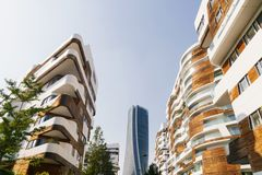Modern architecture design with white and wooden materials in construction. Milan, Italy. royalty free stock photos