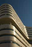 Modern architecture. Detail of a modern white hospital building with a curved façade stock image