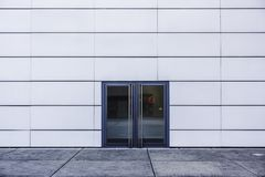 Modern architecture, double glass door and white wall. A double glass door on a white wall, France stock photos