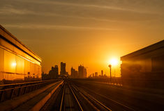 Modern architecture of Dubai, UAE, by sunset seen from a metro car. Royalty Free Stock Photo