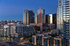 Modern architecture faces the bay in Downtown San Diego, California at Dusk. Downtown San Diego, California skyline at sunset stock images