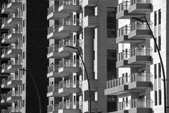 Modern Architecture -generic background. Black and white generic Modern Architecture background - High rise apartment building front view with balcony facade Royalty Free Stock Photos