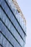 Modern architecture. Modern glass building with sky reflection Royalty Free Stock Photos