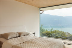Modern architecture, interior, bedroom. Mountain house, modern architecture, interior, bedroom Royalty Free Stock Image