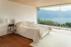 Modern architecture, interior, bedroom. Mountain house, modern architecture, interior, bedroom Stock Photo