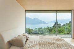 Modern architecture, interior, bedroom. Mountain house, modern architecture, interior, bedroom Stock Photos
