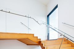 Modern architecture interior with wooden stairs Royalty Free Stock Image