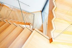 Modern architecture interior with wooden stairs Stock Photo