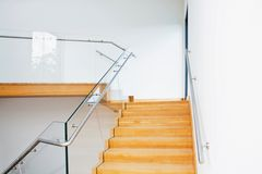 Modern architecture interior with wooden stairs Royalty Free Stock Images