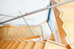 Modern architecture interior with wooden stairs Stock Image